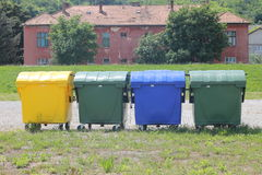Containers for the disposal of waste. Containers of various colors on the street Royalty Free Stock Photography