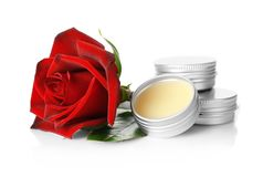 Containers with dry perfume and rose. On white background Stock Image