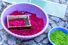 Containers of dyed sawdust to make Palm Sunday procession carpets, Antigua, Guatemala. Containers of dyed sawdust & sieve to make Palm Sunday procession carpets royalty free stock photo