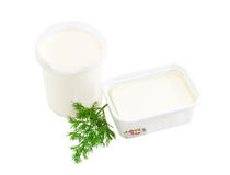 Containers of feta cheese and cream, branch of a dill Stock Photography