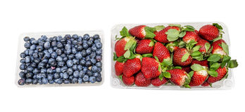 Containers full of fresh Blueberries and Strawberries Royalty Free Stock Image