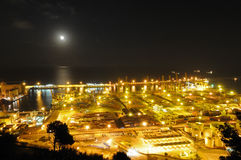 Containers in a harbour. Night Panoramic view of containers in a harbour royalty free stock images