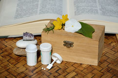 Containers of homeopathic remedies with small chest Stock Photos