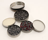 Containers of lead air gun pellets stock photography