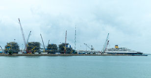 Containers loading by crane in cloudy day , Royalty Free Stock Photography