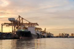 Containers loading by crane in the morning , Trade Port , Shipping.  stock photos