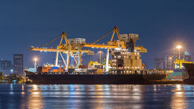 Containers loading by crane Stock Photography