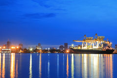 Containers loading at sea trading port Stock Photography