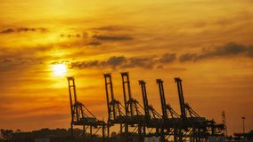 Containers loading shipping crane at morning. The containers loading shipping crane at morning royalty free stock image
