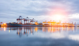 Containers loading Shipping by crane. At morning or Trade Port royalty free stock photos