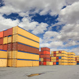 Containers in logistic harbor. Containers waiting to be loaded in international harbor Stock Photo