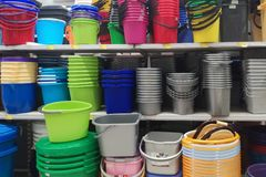 Containers made of plastics, many colors and prices are placed in the warehouse royalty free stock photo