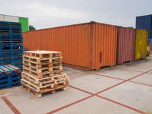 Containers and pallets. Waiting on a  trading site Royalty Free Stock Images