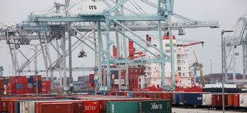 Containers and Port Equipment Royalty Free Stock Images