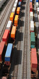 Containers on rails. Container transportation by train is an efficient way of moving cargo across the continent. This concentration of containers has just been stock image