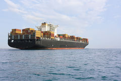 Containers ship. Low view in a bright sunny day Royalty Free Stock Photo
