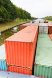 Containers on ship in river Royalty Free Stock Photography