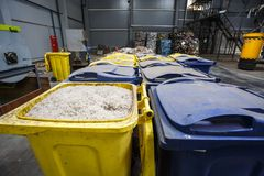 Containers with shredded plastic prepared for further processing remelting and recycling with shredder and bales of plastic waste stock photography