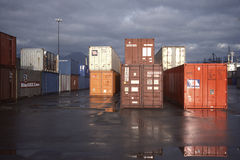 Containers sitting on shipping dock Stock Photos