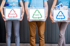Containers with sorted waste. Holding containers with glass, paper and plastic waste royalty free stock photography