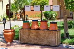 Containers for sorting garbage in the form of clay pots in Hurgh. Ada, Egypt. The concept of environmental waste collection. Outdoors Stock Image