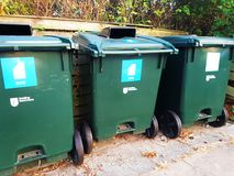 Containers for sorting garbage. Green garbage bins for a clean environment Stock Photo