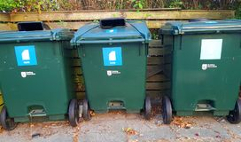 Containers for sorting garbage. Green garbage bins for a clean environment royalty free stock photo