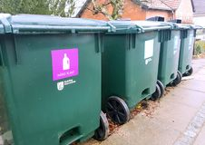 Containers for sorting garbage. Green garbage bins for a clean environment Royalty Free Stock Images