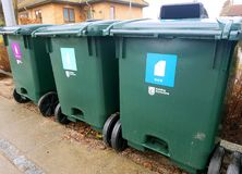 Containers for sorting garbage. Green garbage bins for a clean environment royalty free stock image