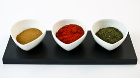Containers with spices. On a white background Royalty Free Stock Images