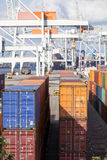 Containers stacked at harbor Stock Image