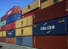 Containers stacked on pile. Several containers from diverse maritime agencies stacked on portugues harbor leixões Stock Photos