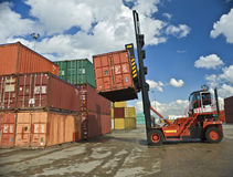 Containers staking. Containers forklift at work in port Royalty Free Stock Photos