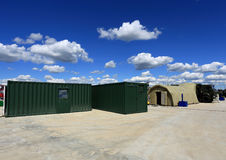 Containers and the tent Royalty Free Stock Photos