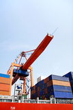 Containers under crane Royalty Free Stock Photo