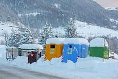 Containers and waste bins along the snow covered mountain road Royalty Free Stock Photos