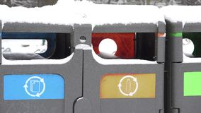 Containers for waste recycling in winter time. 4K. Containers for waste recycling in cold winter time. 4K stock video