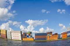 Containers from Yangming, Hapag-Loyd, MSC, NYK, Triton, Gold are placed along the shore. Royalty Free Stock Images