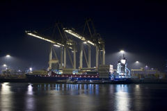 Containership. A containership unloading in Rotterdam royalty free stock images