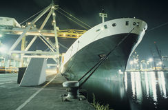 Containership being loaded in dock at night Royalty Free Stock Images