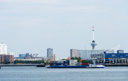 Containership entering rotterdam harbor Royalty Free Stock Image