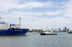 Containership entering rotterdam harbor Royalty Free Stock Images