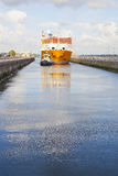 Containership entering the sea lock at Velsen, The Netherlands Royalty Free Stock Photos