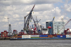 Containership in Rotterdam harbor Stock Photos