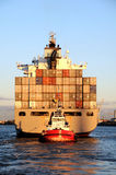 Containership in sunset Stock Images