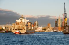 Containership in sunset Stock Photos