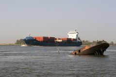 Containership and wreck Royalty Free Stock Images