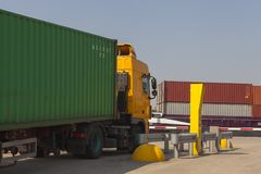 Containertruck on terminal ready to deliver a container royalty free stock images