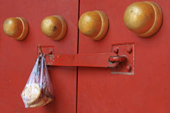 Containing food plastic bag hang at the door Stock Photography