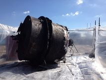 Asbestos on demolished vessel. Containment area where asbestos on industrial vessel awaits removal Stock Photos
